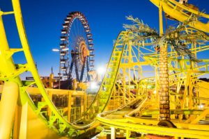 yellow rollercoaster ride with lots of curves and change directions